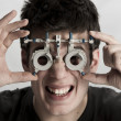Optometrist in exam - Stock Photo