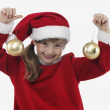 Royalty-Free Stock Photo: Cute little girl with two christmas balls