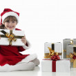 Royalty-Free Stock Photo: A little girl and xmas presents on white background