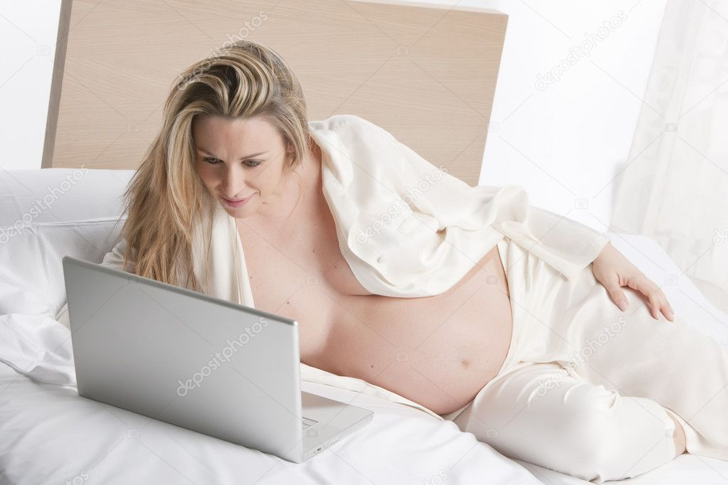 Pregnant woman working on a laptop  Stock Photo #11180996