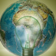 Bulb and overuse global energy concept - Stock Photo