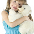 Little girl is hugging big teddy bear - Stock Photo