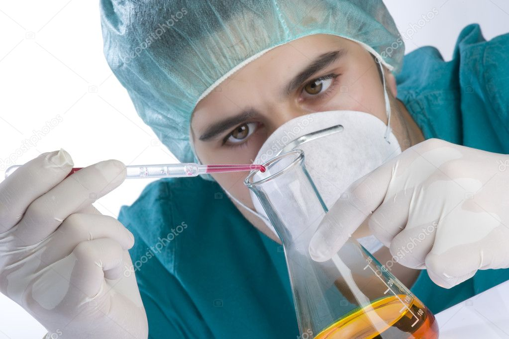 Scientist taking a probe in a labor scene with testtubes and beaker Shallow DOF the Focus is on the little bottle and the hand — Stock Photo #11191859