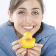 Royalty-Free Stock Photo: Young girl in bathrobe with yellow duck