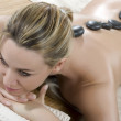 Royalty-Free Stock Photo: Hot stone massage in the day spa