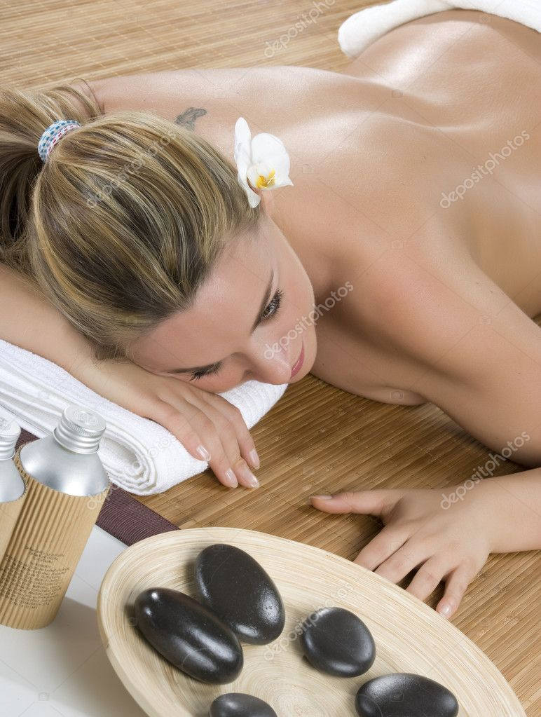 Beautiful woman have hotstone massage at spa and wellness center  Stock Photo #11321492