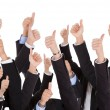 A bunch of raised hands - Stock Photo