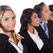 Confident business team with headsets — Stock Photo