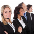 Stock Photo: Confident business team with headsets