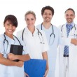 Stock Photo: Group of doctors standing together over white