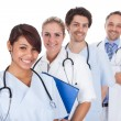 Group of doctors standing together over white — Stock Photo