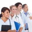 Group of doctors standing together over white — Stock Photo #10864480