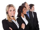 Team di business sicuri con auricolari — Foto Stock