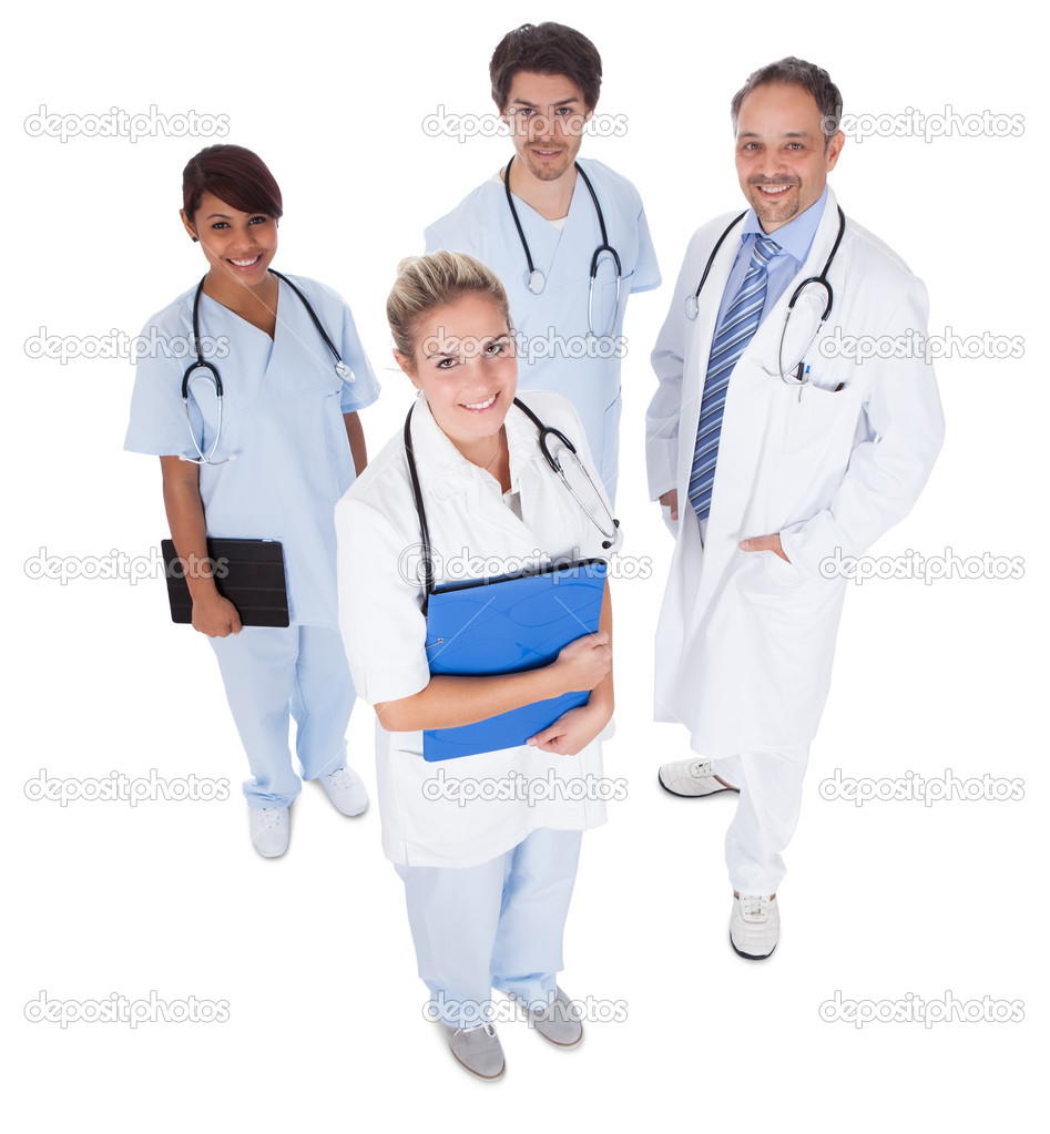 Group of doctors standing together isolated over white background — Stock Photo #10864515
