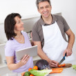 Senior couple cooking lunch at home — Stock Photo