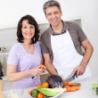 Senior couple cooking lunch at home — Stock Photo #10917024