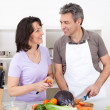 Senior couple cooking lunch at home — Stock Photo #10917044