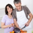 Stock Photo: Senior couple cooking lunch at home