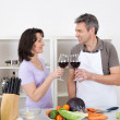 Senior couple cooking at home — Stock Photo