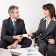 Two business exchanging visiting card — Stock Photo #10918375