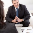 Mature businessman at the interview — Stock Photo #10918478