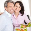 Mature couple having lunch at home — Stock Photo #10918816