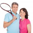 Mature couple with tennis racquets — Stock Photo #10918849