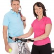 Mature active couple doing sports — Stock Photo