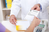Buying prescription medicine at drugstore — Stock Photo