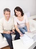 Mature couple doing family finances — Stock Photo