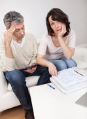 Mature couple in financial trouble — Stock Photo