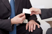 Two business exchanging visiting card — Stock Photo