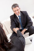 Mature businessman at the interview — Stock Photo