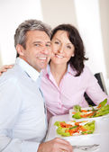 Mature couple having lunch at home — Stock Photo