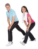 Active mature couple doing fitness — Stock Photo