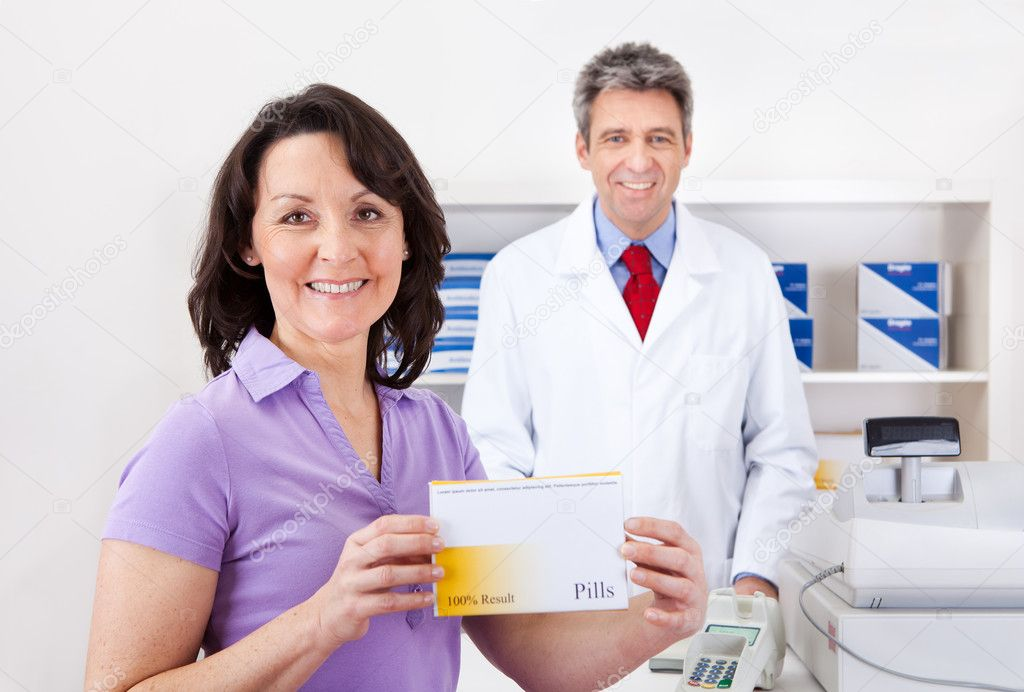 Portrait of senior woman buying medicine at drug store — Stock Photo #10917564