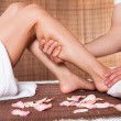 Beautiful young woman getting feet massage — Stock Photo #11083184