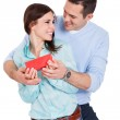 Young man giving present to his girlfriend — Stock Photo