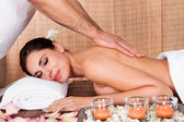 Beautiful young woman getting back massage — Stock Photo