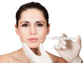 Beautician doing face injection to woman — Stock Photo