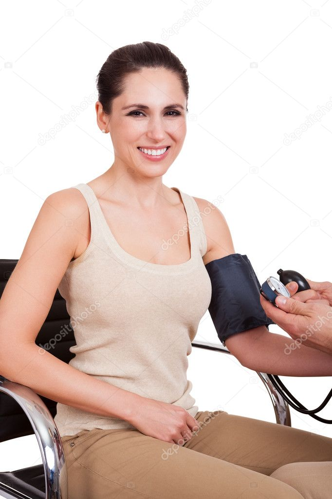 Doctor checking blood pressure of young woman. Isolated on white — Stock Photo #11083669