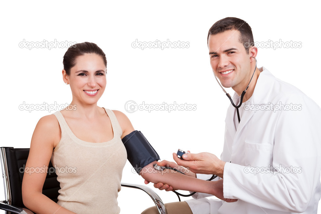 Doctor checking blood pressure of young woman. Isolated on white  Stock Photo #11083710