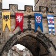 Medieval flags of Old Town bridge tower, Prague,,, — Stock Photo