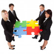 Group of business assembling puzzle — Stock Photo