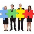 Group of business assembling puzzle — Stock Photo #11453460