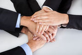 Business colleagues with hands stacked together — Stock Photo