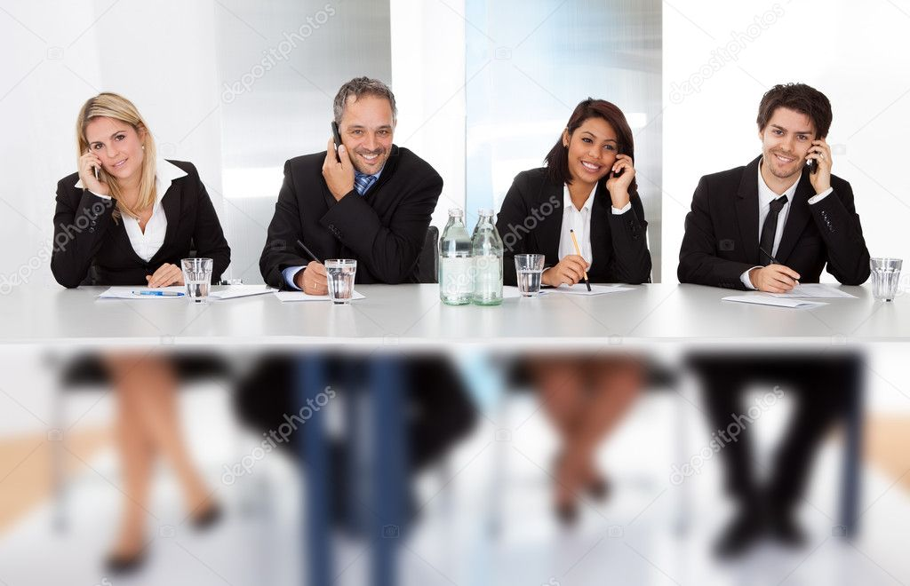 Group of business talking on the phones at the meeting — Stock Photo #11453431