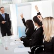Business at presentation raising hands — Stock Photo