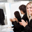 Businesswoman at presentation applauding — Stock Photo