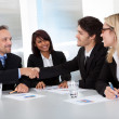 Stock Photo: Group of business at the meeting